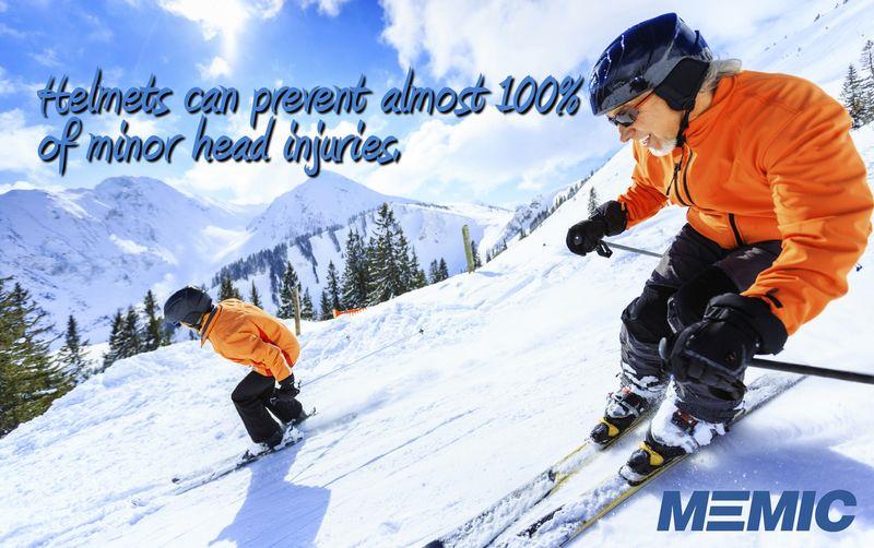 Skiers wearing helmets.